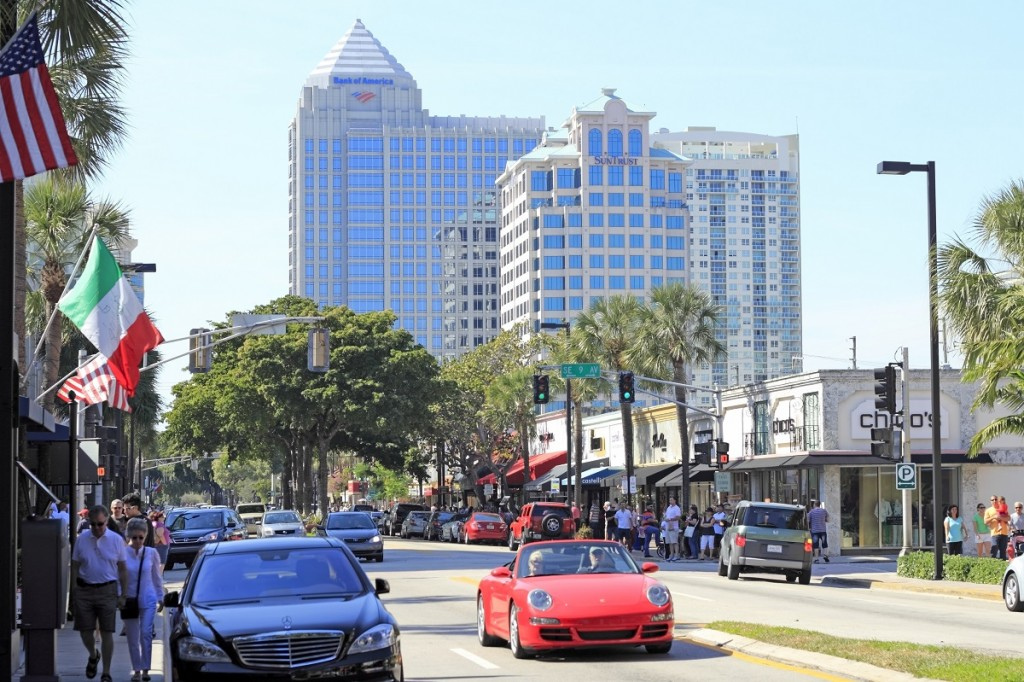 FORT LAUDERDALE, FLORIDA - FEBRUARY 3, 2013:  Las Olas Boulevard shoppers drive and walk to visit stores, upscale shops and eateries in the downtown neighborhood.
