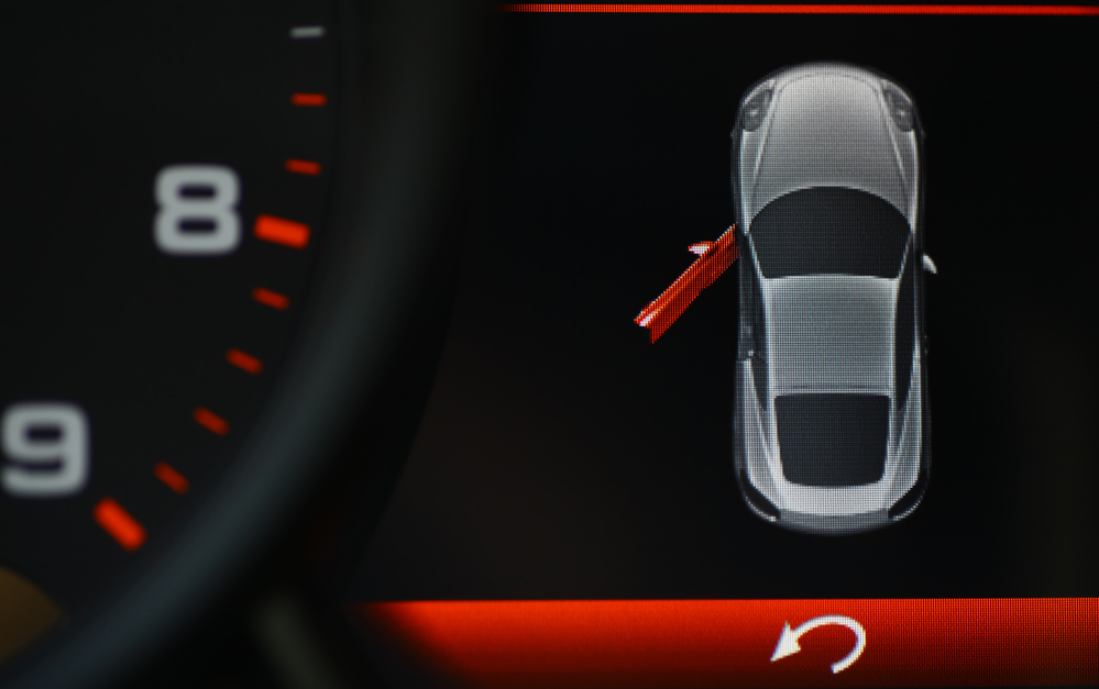 Color detail of an error message on a car's dashboard, indicating a door is opened.