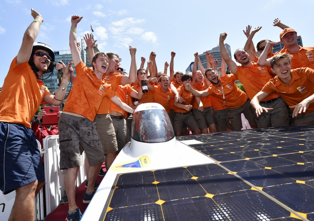 Nuon solar team from Holland celebrate after crossing the line in Adelaide to win the World Solar Challenge on Thursday, Oct. 22, 2015. Twenty-nine high-tech vehicles from 17 countries have been making their way through the desert from Darwin to Adelaide as part of the 2015 World Solar Challenge in Australia. (AAP Image/David Mariuz) NO ARCHIVING